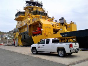 pf collins truck in front of vessel showing  importing a vessel into canada or importing a boat